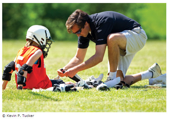 Lacrosse coach ties player's shoe