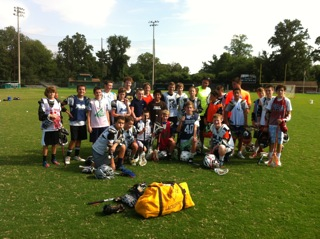 A photo of a group of boys in their LAX gear following a clinic