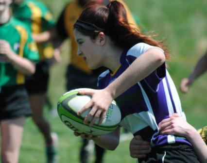 This image depicts a teenage girl displaying general rugby awesomeness