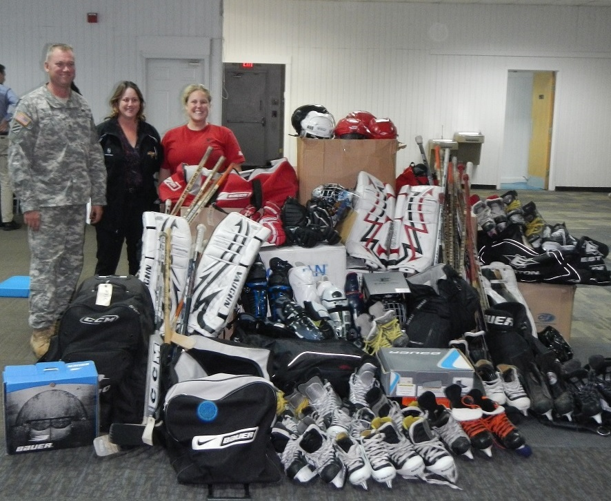 Staff Sergeant Mike Duke, Marcella Hanyok and Ft Bragg Cleland Rink Manager Linda Duke