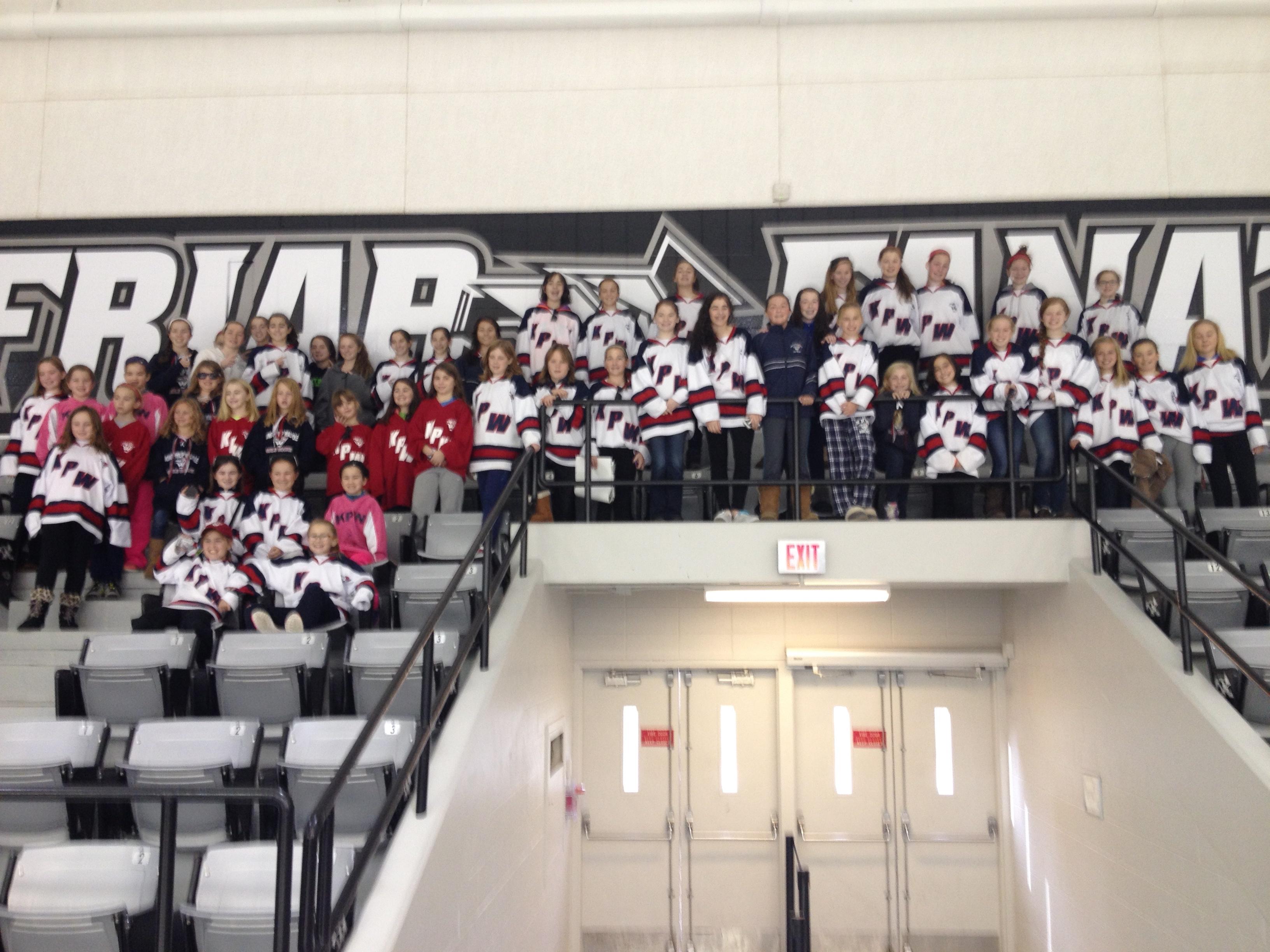 King Philip Walpole girls hockey players enjoying a women's hockey game at Providence College.