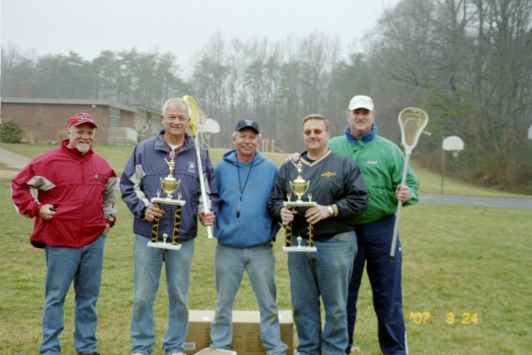 2006 Trophy Presentations by Joseph Weiss (Lacrosse Commissioner, center) to Juniors and Middies Coaching Staffs (left to right, Love, Dirks, Weiss, Coffman, Kalb)