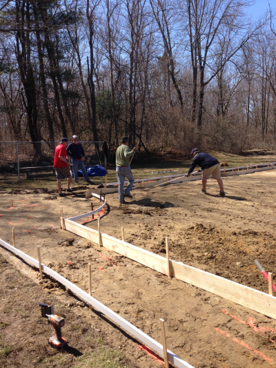 Volunteers at work on the new field. Spring of 2014