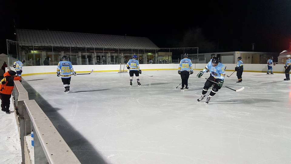 Jack kirrane skating rink with MAHL players