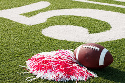 """Quick and easy DIY pom poms are the perfect way to cheer on your favorite sports team and show your team spirit! Great for kids and adults alike! These DIY pom poms are super easy and inexpensive to make, and they're perfect for cheering on your favorite team during the Super Bowl or any other """"Big Game"""" of the year!"""